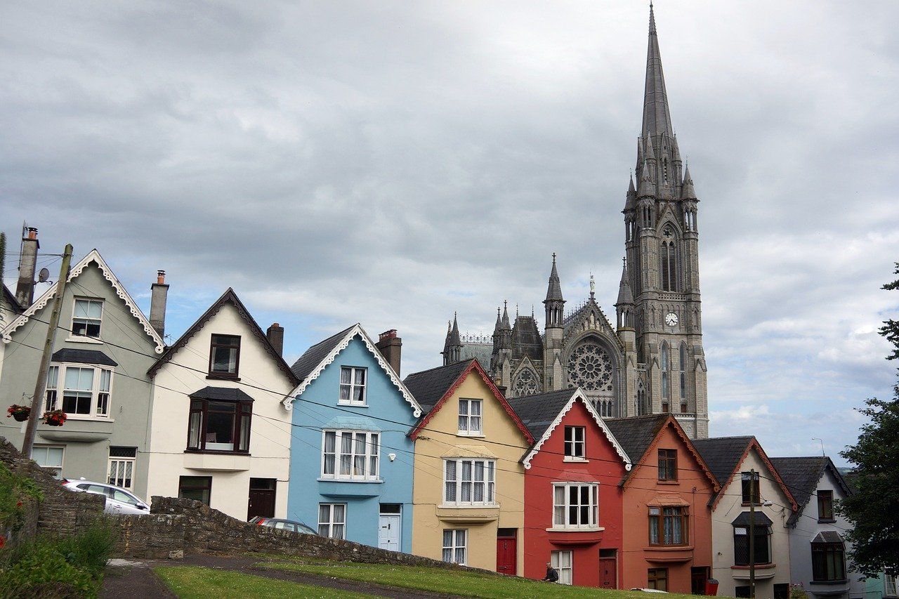 houses with church steeple behind them
